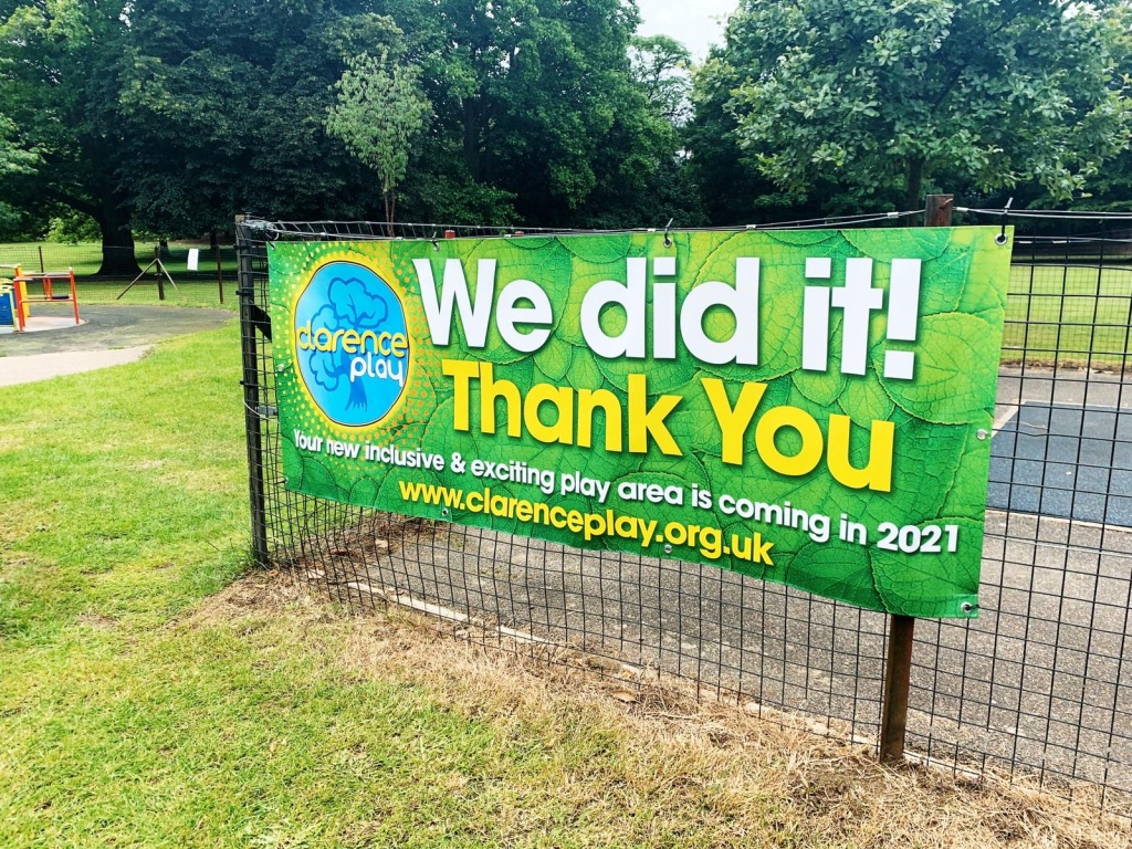 Photograph of a banner stating We Did it!